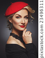 Beautiful lady in red beret 23496311