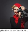 Beautiful lady with retro photo camera 23496351