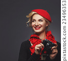 Beautiful lady with retro photo camera 23496353