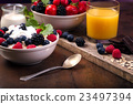 Healthy breakfast and berries with yoghurt. 23497394