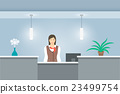 Woman receptionist stands at reception desk 23499754