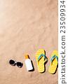 Flip flop sandals, sunglasses and sunscreen, sand 23509934