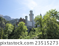 Neuschwanstein Castle behind trees  23515273