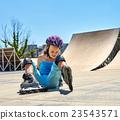 Girl riding on roller skates in skatepark. 23543571