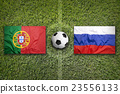 Portugal vs. Russia flags on soccer field 23556133
