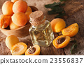 Aromatic apricot oil in a glass bottle close-up 23556837