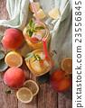 Fresh peach lemonade with ice and mint  23556845