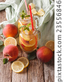 Fruit lemonade with peaches, ice and mint  23556846