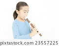 Girl playing a whistle Girl blowing a recorder 23557225