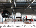 Interior of car repair station,cars on maintenance 23566576
