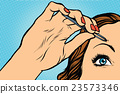 woman plucking eyebrows depilating with tweezers 23573346