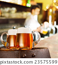 Two glasses of beer in the bar 23575599