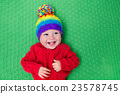 Little baby in warm knitted hat 23578745
