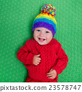 Little baby in warm knitted hat 23578747