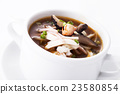 Sichuan sour soup serve in white bowl 23580854