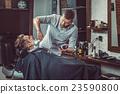 Hipster client visiting barber shop 23590800