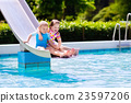Kids on water slide in swimming pool 23597206