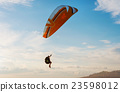 Man with glider on the sky blue sky 23598012