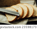 Sliced bread and knife on linen cloth 23598173