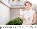 woman in chinese dress holding couplet  23601518
