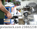 Blue-collar worker doing manual labor with a lathe 23602238