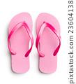 Pink flip flops. 23604138