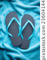 flip flops and towel 23604144