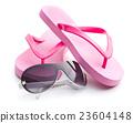 Flip flops and sunglasses. 23604148