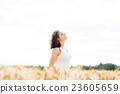 Young and happy woman in a meadow of rye 23605659