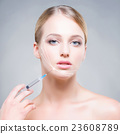 Portrait of a blond woman injecting with a syringe 23608789