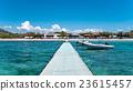 Dock in beautiful blue sea under a clear sky.  23615457
