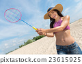 Nice sporty woman playing badminton 23615925