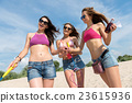 Cheerful women resting on the beach 23615936