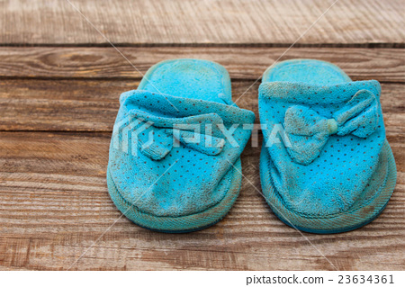 Old dirty homemade slippers 23634361