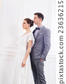 Bride in a white dress and a handsome groom 23636215