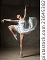 Beautiful ballerina dancing in white dress 23645382