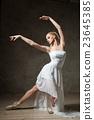 Beautiful ballerina dancing in white dress 23645385