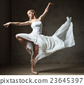 Beautiful ballet dancer in white costume with 23645397