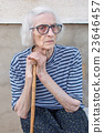 Senior women supporting on a walking cane 23646457