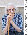 Senior women supporting on a walking cane 23646458
