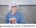 Senior women supporting on a walking cane 23646462