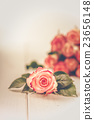 Fragrant flowers on wooden background 23656148