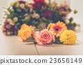 Fragrant flowers on wooden background 23656149