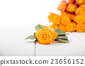 Fragrant flowers on wooden background 23656152