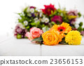 Fragrant flowers on wooden background 23656153