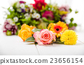 Fragrant flowers on wooden background 23656154