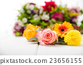 Fragrant flowers on wooden background 23656155