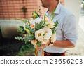 Beautiful wedding bouquet in hands of the groom 23656203