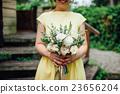 Beautiful wedding bouquet in hands of the bride 23656204