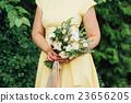 Beautiful wedding bouquet in hands of the bride 23656205
